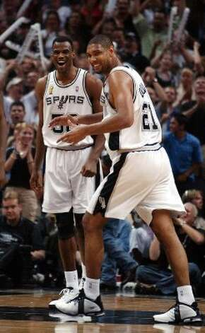San Antonio Spurs David Robinson and Tim Duncan celebrate as they take a commanding lead during the fourth quarter  in game six of the NBA Finals at SBC Center in San Antonio on Sunday, June 15, 2003. The beat the New Jersey Nets for the NBA Championship title.   (JERRY LARA / SAN ANTONIO EXPRESS-NEWS)