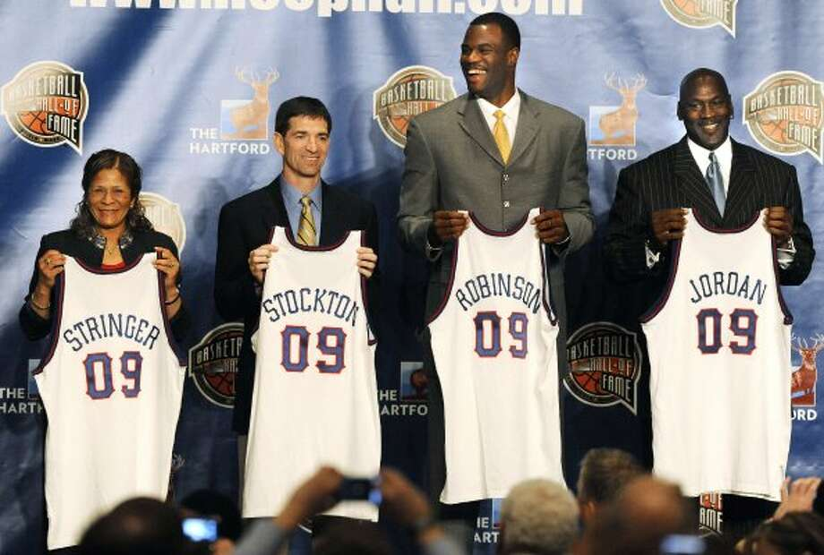 Rutgers women's coach C. Vivian Stringer, and former NBA basketball players John Stockton, David Robinson and Michael Jordan, holding jerseys, in Detroit, at the announcement that they were elected to the Basketball Hall of Fame. Utah Jazz coach Jerry Sloan, not shown,  is also part of the 2009 class. April 6, 2009.  (Daniel Mears / Associated Press)