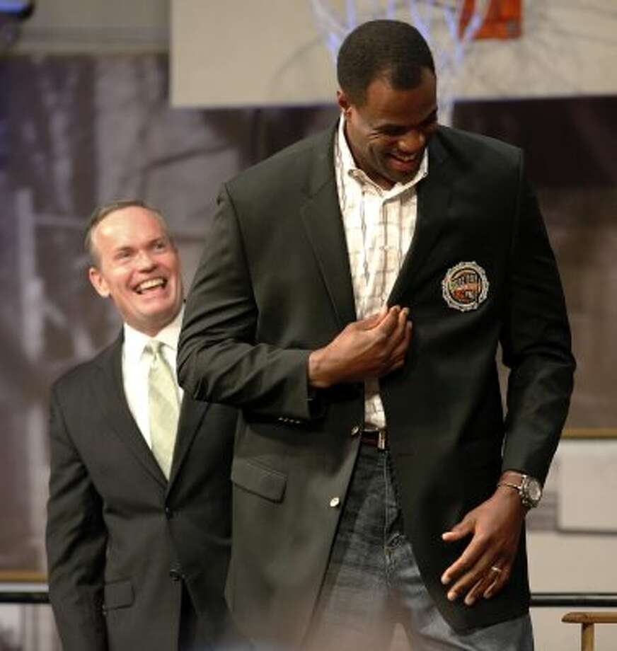 David Robinson (right) tugs on his jacket after Hall of Fame president John Doleva (left) presented Robinson with the coat during the jacket presentation and press conference at Naismith Memorial  Basketball Hall of Fame in Springfield, Mass. on Friday, Sept. 11, 2009.  (Kin Man Hui / San Antonio Express-News)