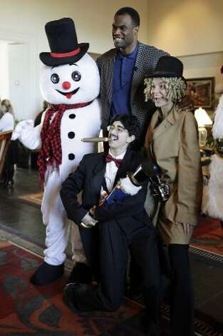 "Former San Antonio Spurs center David Robinson poses with cast and characters from the Hill Country Holidays with The Westin La Cantera Resort, Thursday, Nov. 18, 2010. The Holiday event will through January 8th daily from 11 a.m. to 8 p.m. and features ""Frost,"" a 1,200-square-foot ice skating rink, Christmas book readings and Santa Claus. The rink cost $10 for 45 minutes and proceeds will benefit The Carver Academy. A U.S. Marines Toys for Tots box is also located in the lobby of the resort to collect presents for disadvantage children.  (JERRY LARA / SAN ANTONIO EXPRESS-NEWS)"