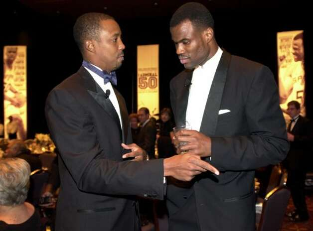 Sean Elliott, Master of Ceremonies, talks with David Robinson prior to the start of Gala honoring Robinson Sunday Nov 9, 2003 at the Henry B. Gonzalez Convention Center.  (Edward A. Ornelas / SAN ANTONIO EXPRESS-NEWS)