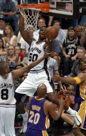 Spurs' David Robinson (50) attempts to recover his own missed dunk in the second half at the Alamodome Friday, May 10, 2002.  (Kin Man Hui / SAN ANTONIO EXPRESS-NEWS)