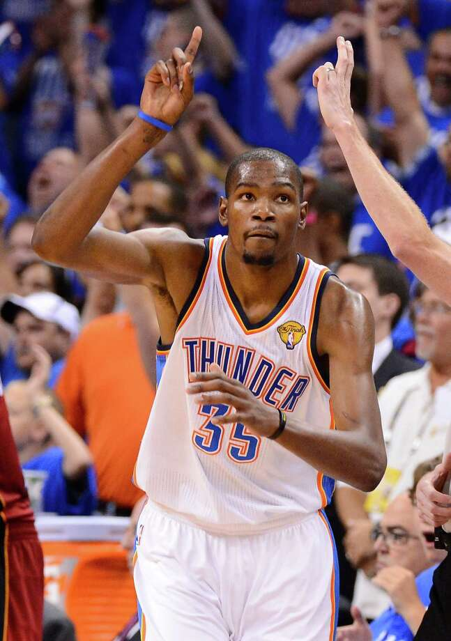OKLAHOMA CITY, OK - JUNE 12:  Kevin Durant #35 of the Oklahoma City Thunder reacts after making a shot in the second half in Game One of the 2012 NBA Finals at Chesapeake Energy Arena on June 12, 2012 in Oklahoma City, Oklahoma. NOTE TO USER: User expressly acknowledges and agrees that, by downloading and or using this photograph, User is consenting to the terms and conditions of the Getty Images License Agreement. Photo: Ronald Martinez, Getty Images / 2012 Getty Images