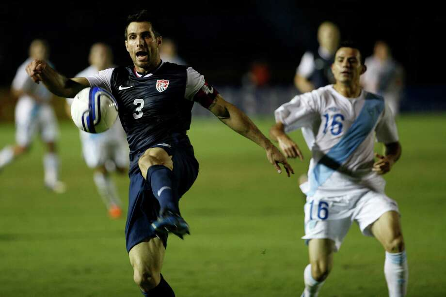 United States' Carlos Bocanegra, left, clears the ball. Photo: Moises Castillo, Associated Press / AP