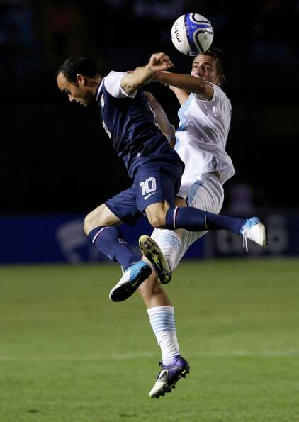 Guatemala's Manuel Leon and United States' Landon Donovan, left, go for a header.