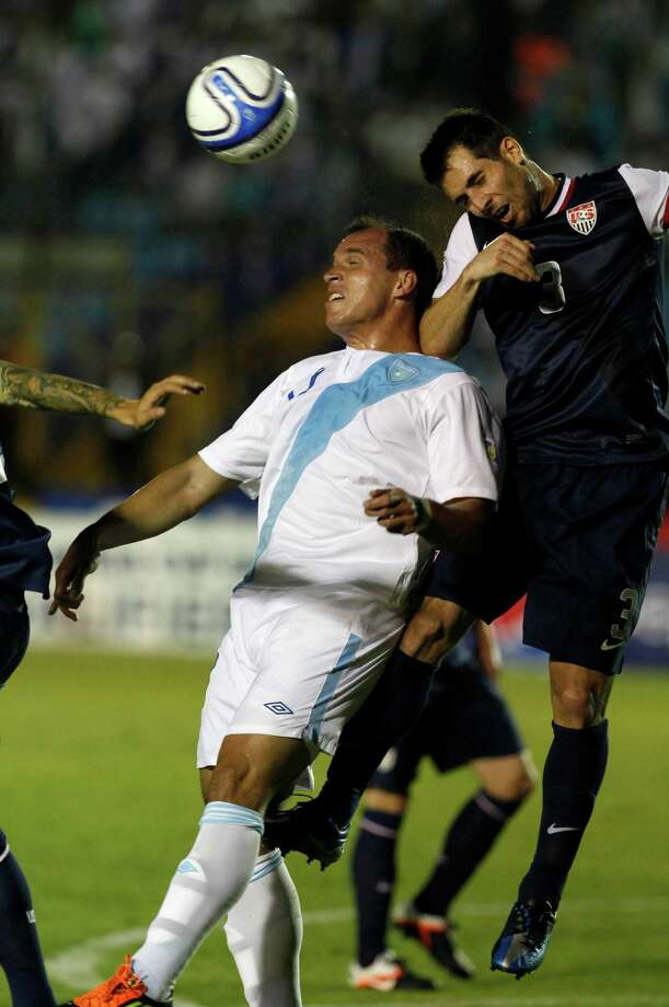 Guatemala's Dwight Pezzarossi and United States' Carlos Bocanegra, right, go for a header. Photo: Moises Castillo, Associated Press / AP