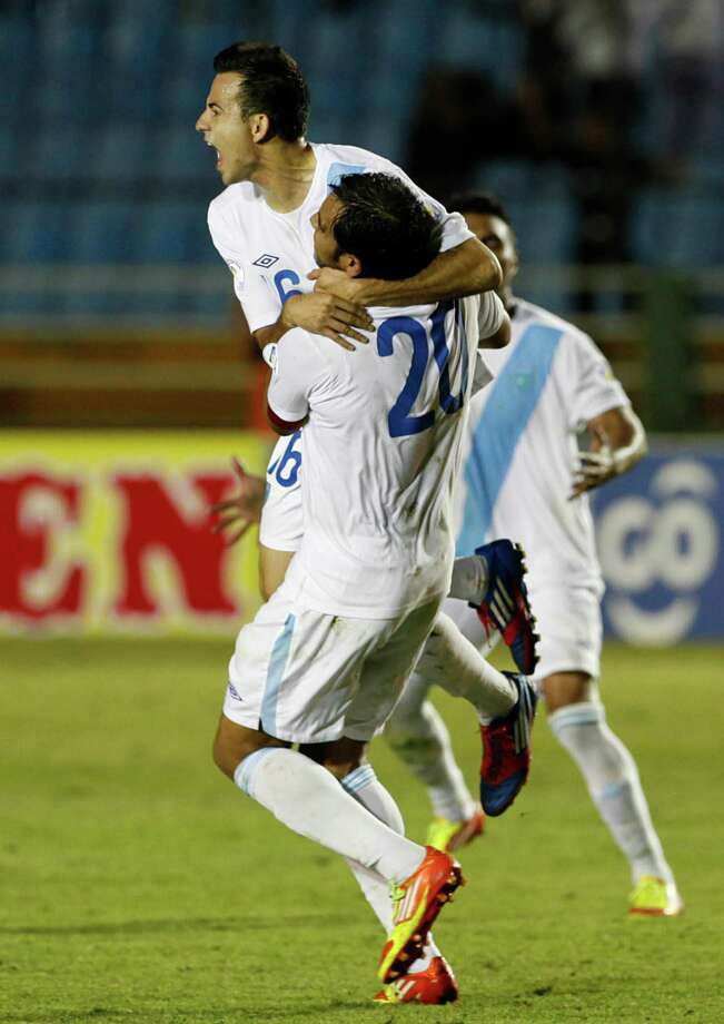 Guatemala's Marco Pappa, top, celebrates with teammates after scoring against the United States. Photo: Moises Castillo, Associated Press / AP