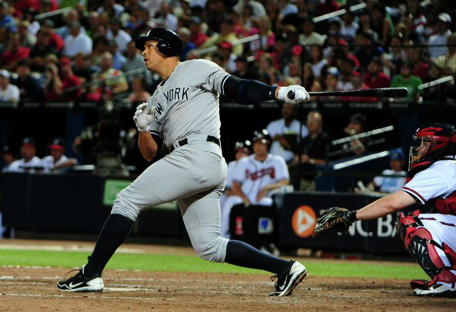 Alex Rodriguez connects on the 23rd grand slam of his career, tying Lou Gehrig for the all-time record and setting the Yankees' winning rally in motion Tuesday. Photo: Scott Cunningham / 2012 Getty Images