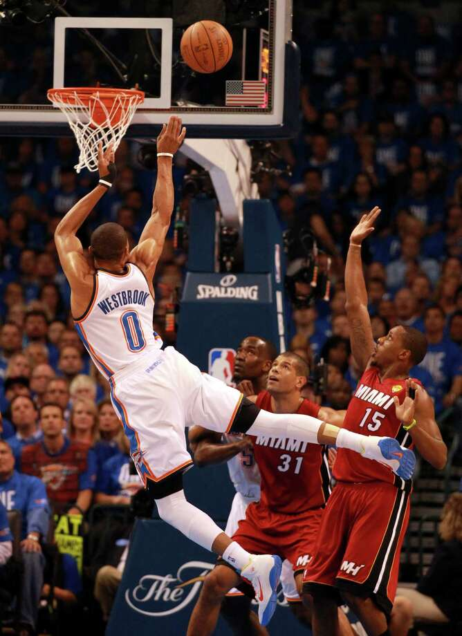 After building a 13-point lead, the Heat were caught flat-footed as Russell Westbrook (0) combined with Kevin Durant to lead the Thunder's rally. Westbrook had 27 points and 11 assists. Photo: CHARLES TRAINOR JR / Miami Herald