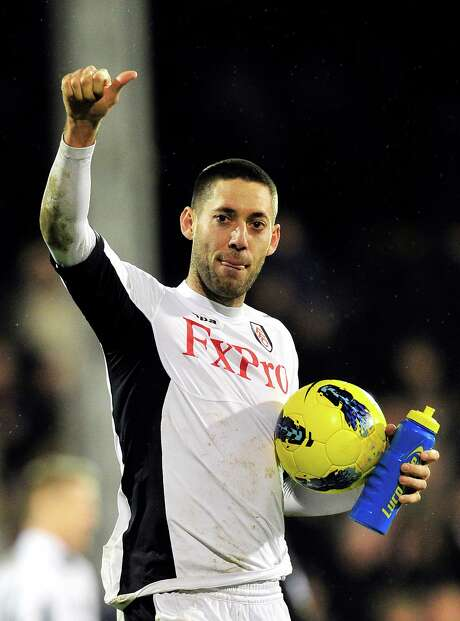 Fulham's US midfielder Clint Dempsey celebrates walks off with the match ball after his hat-trick in their 5-2 victory in the English Premier League football match between Fulham and Newcastle United at Craven Cottage in London, England on January 21, 2012. AFP PHOTO/GLYN KIRK  RESTRICTED TO EDITORIAL USE. No use with unauthorized audio, video, data, fixture lists, club/league logos or â??liveâ? services. Online in-match use limited to 45 images, no video emulation. No use in betting, games or single club/league/player publications (Photo credit should read GLYN KIRK/AFP/Getty Images) Photo: GLYN KIRK / AFP