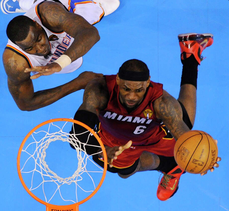 Miami Heat small forward LeBron James  shoots against Oklahoma City Thunder center Kendrick Perkins (5) during the second half at Game 1 of the NBA finals basketball series, Tuesday, June 12, 2012, in Oklahoma City. The Thunder won 105-94. (AP Photo/Larry W. Smith, Pool) Photo: Larry W. Smith, Associated Press / EPA Pool