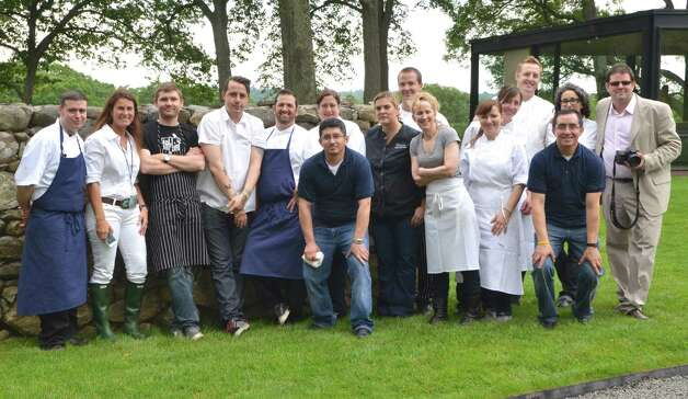 The featured chefs and their assistants gather for a photo with Pamela Duevel, president of Pamela Duevel PR (second from left) and her partner for Dine with Design at the Glass House event, Darryl Estrine, author of Harvest to Heat (far right).  June 9, 2012, New Canaan, Conn. Photo: Jeanna Petersen Shepard