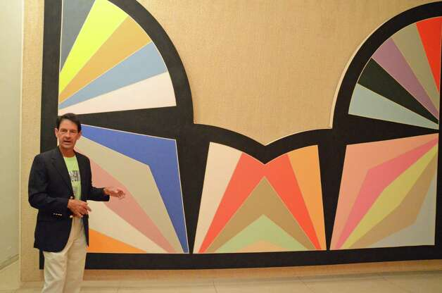 Peter Daniel discusses one of the Frank Stella paintings inside the Painting Gallery during the Dine with Design event at the Glass House last Saturday, June 9, 2012, in New Canaan, Conn. Photo: Jeanna Petersen Shepard