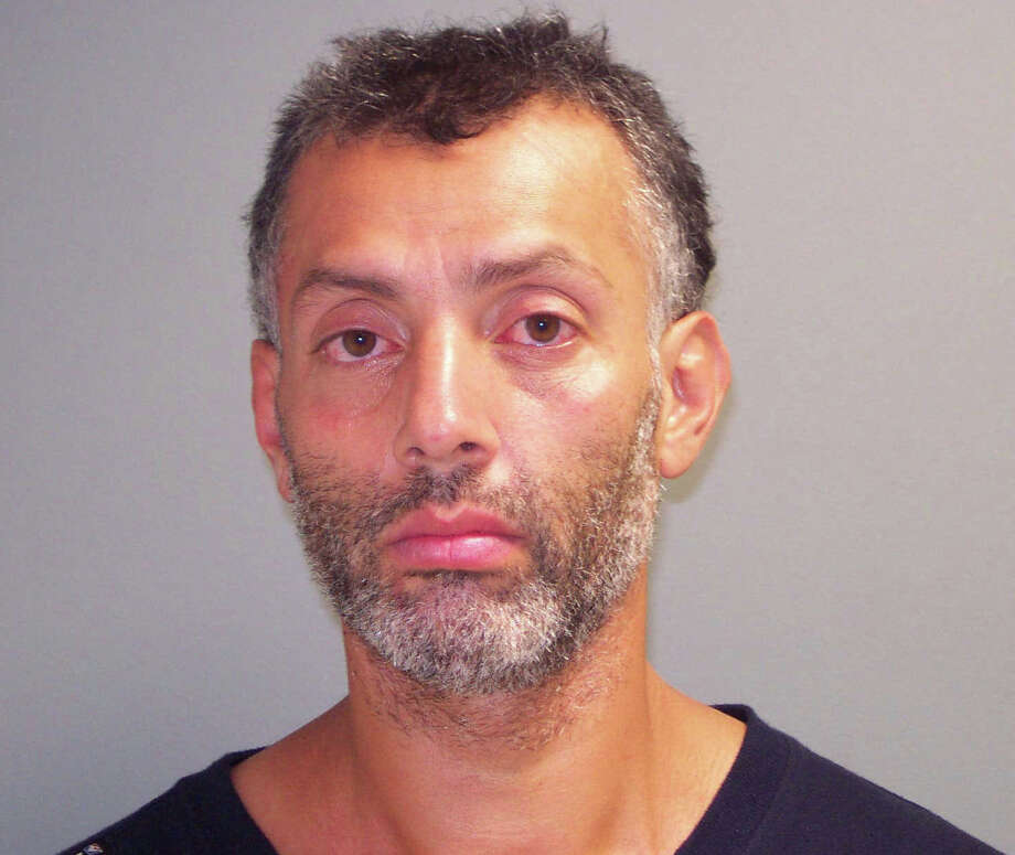 Two Norwalk men arrested Monday evening and charged with stealing a Ford Explorer were being sought by Greenwich police for the attempted theft of a motorcycle in Greenwich earlier that night, police said. George Buruca, 40, of 80 S. Main, Norwalk, and Anibal Grave, 24, of 26 Ely Ave. Norwalk, were charged with third-degree larceny and held in lieu of $25,000 bond. Photo: Contributed Photo