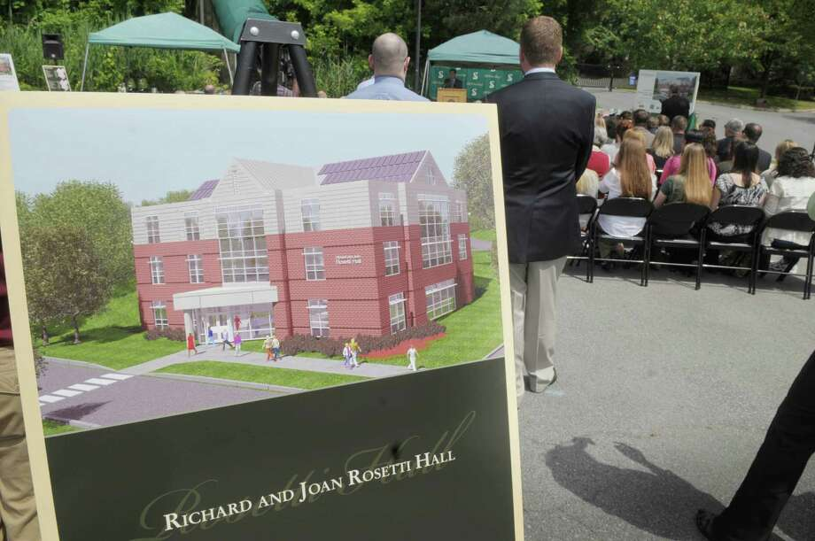 An artists rendition of the Richard and Joan Rosetti Hall is seen on display during a groundbreaking ceremony for a new academic building on Thursday, June 7, 2012 at Siena College in Loudonville, NY.  The Richard and Joan Rosetti Hall will be the  first LEED certified construction on the Siena College campus.  The building?s design incorporates a geothermal heating and cooling system, photo-voltaic solar panels, LED lighting.  The 23,225 square-foot building is scheduled to open in September 2013 and will house the departments of education, sociology and social work.  (Paul Buckowski / Times Union) Photo: Paul Buckowski / 00017999A