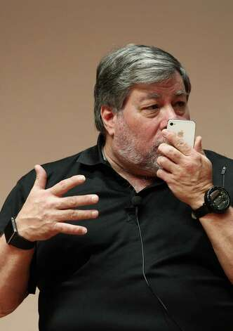 Steve Wozniak, co-founder of Apple Inc., holds an iPhone as he speaks at Hanyang University in Seoul, South Korea, on Thursday, May 31, 2012. Wozniak is chief scientist at Fusion-io Inc., a maker of flash-memory technology. Photographer: SeongJoon Cho/Bloomberg *** Local Caption *** Steve Wozniak Photo: SeongJoon Cho, Bloomberg / © 2012 Bloomberg Finance LP