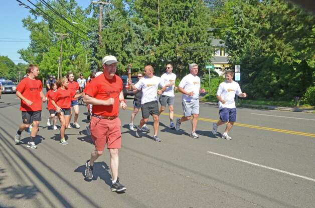 Special Olympic athlete Kevin Pirro takes the lead during the Special Olympics Law Enforcement Torch run last Friday morning, June 8, 2012.  Darien, Conn. Photo: Jeanna Petersen Shepard