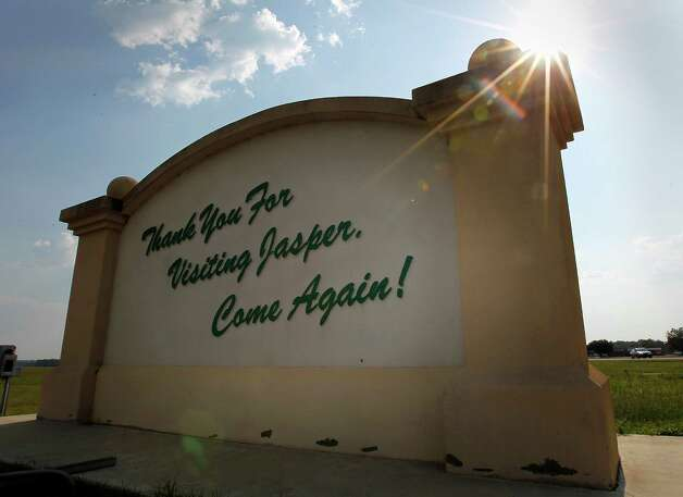 "The back of the ""Welcome to Jasper"" sign, Tuesday, Aug. 30, 2011, in Jasper, Texas.  Rodney Pearson, who was named Chief of police in Jasper, by the city council, but was disputed by citizens in the community, which has sparked debate in the city, dividing the city along racial lines. Several citizens in Jasper have signed a petition asking to recall council members Terrya Norsworthy and her fellow councilmen Willie Land and Tommy Adams.  This, as the state of Texas prepares to put the first of the James Byrd killers to death in three weeks.  ( Karen Warren / Houston Chronicle ) Photo: Karen Warren, Staff / © 2011 Houston Chronicle"