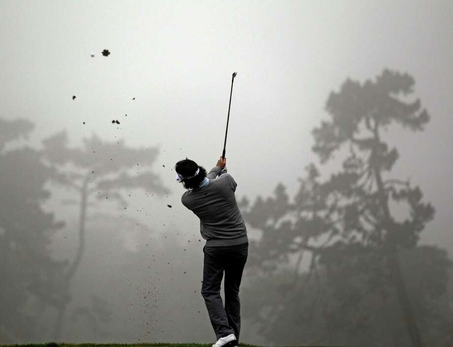 Bubba Watson hits a shot on the second hole during a practice round for the U.S. Open Championship golf tournament Wednesday, June 13, 2012, at The Olympic Club in San Francisco. Photo: David J. Phillip, Associated Press / AP