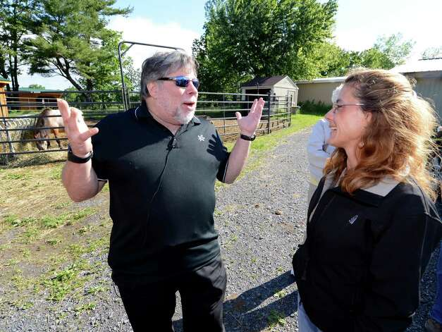"Steve Wozniak, co-founder of Apple Computer speaks with Nanci Beyerl, founder and Executive Director of Peaceful Acres Horses Inc. in Patersonville, N.Y. June, 13, 2012.  Wozniak was visiting the farm to meet ""Woz"" a horse that was rescued from a kill pen.  Peaceful Acres Horses Inc. is a farm that rescues horses of all breeds and rehabilitates them with the aid of donations and volunteers.  They also incorporate human rehabilitation with animals as part of their mission.    (Skip Dickstein / Times Union) Photo: SKIP DICKSTEIN / 00018075A"
