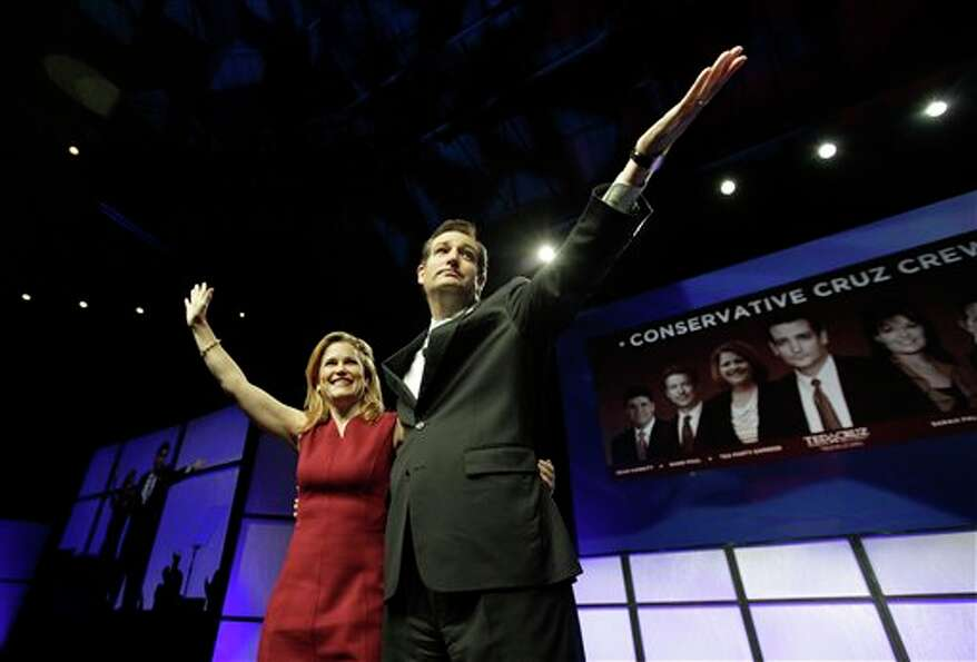 U.S. Senate Candidate Ted Cruz, left, and his wife Heidi Cruz wave after his speech during the Texas