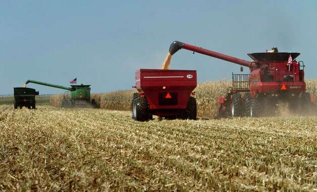 FILE - In this Sept. 15, 2010, file photo, combines, costing several hundred thousand dollars each, harvest a field during a corn harvesting demonstration at the Husker Harvest Days fair, in Grand Island, Neb. A program that puts billions of dollars in the pockets of farmers whether or not they plant a crop may disappear with hardly a protest from farm groups and the politicians who look out for their interests. The Senate is expected to begin debate the week of June 4, 2012, on a five-year farm and food aid bill that would save $9.3 billion by ending direct payments to farmers and replacing them with subsidized insurance programs for when the weather turns bad or prices go south. Photo: AP