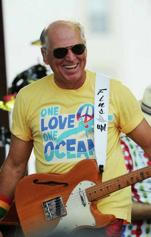 Musician Jimmy Buffett attracts hard-core fans who love the tropical life captured in his songs. Photo: Getty Images