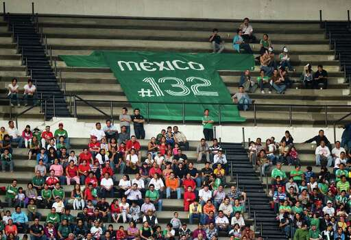 "Members of the new movement called ""Yo soy 132"" (I am #132) display a big T-shirt with the logo of his organization during a match between Mexico and Guyana during their FIFA World Cup Brazil 2014 North, Central America and Caribbean qualifier football match at the  Azteca stadium in Mexico City on June 08, 2012. AFP PHOTO/RONALDO SCHEMIDT        (Photo credit should read Ronaldo Schemidt/AFP/GettyImages) Photo: RONALDO SCHEMIDT, Getty Images / 2012 AFP"