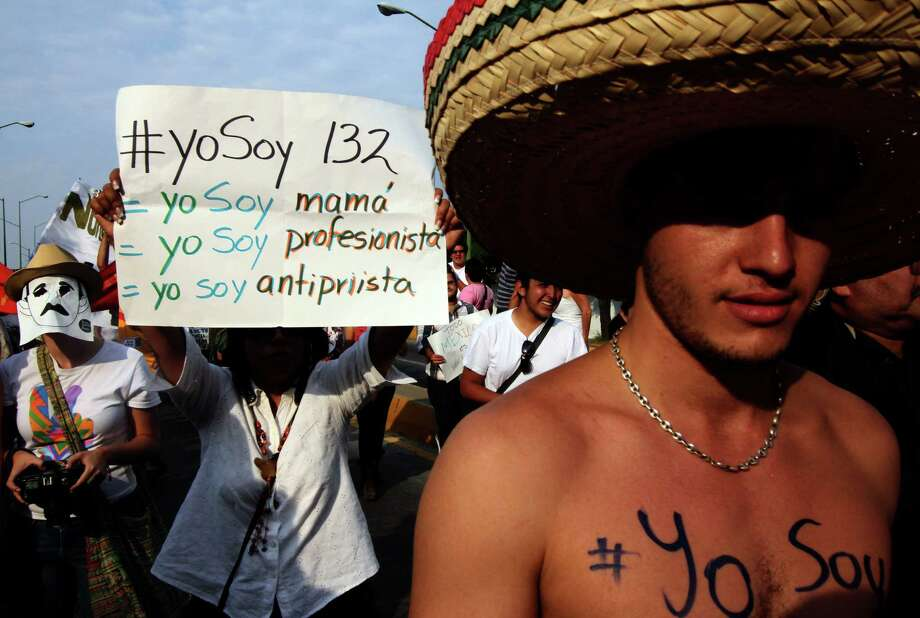 "Members of the ""Yo soy 132"" (I Am #132) movement march during a protest against the Mexican television, to demand fair broadcasting and electoral information in Guadalajara city, Mexico on June 10, 2012. Mexico will hold presidential elections next July 1, 2012. AFP PHOTO/Hector Guerrero        (Photo credit should read HECTOR GUERRERO/AFP/GettyImages) Photo: HECTOR GUERRERO, Getty Images / 2012 AFP"