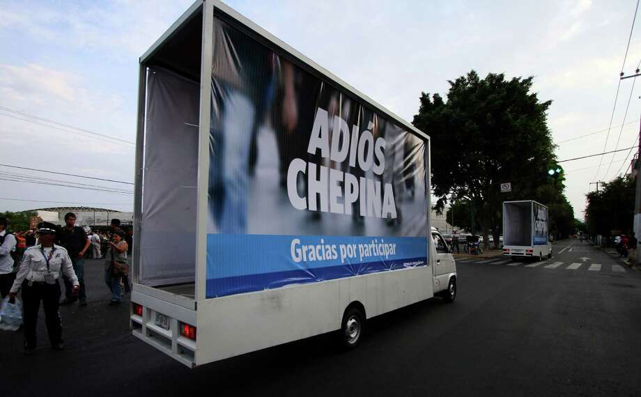 "A truck displaying a poster reading ""Goodbye Chepina - Thanks for participating"" --in allusion to Mexican presidential candidate Josefina Vazquez Mota of the Natioanl Action Party (PAN)-- drives in front of the building where the second presidential debate is taking place in Guadalajara City, state of Jalisco, on June 10, 2012. Mexico will hold presidential elections next July 1, 2012. AFP PHOTO/Hector Guerrero        (Photo credit should read HECTOR GUERRERO/AFP/GettyImages) Photo: AFP, Getty Images / 2012 AFP"