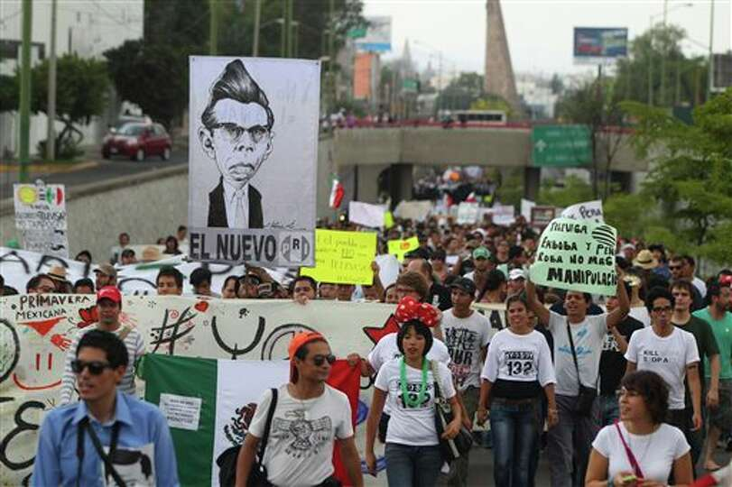 Students belonging to the 132 movement march towards the second presidential debate site in Guadalaj