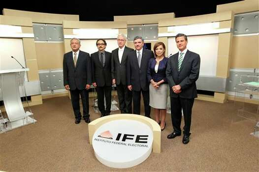 In this undated image released by Mexico's Federal Electoral Institute, IFE, the presidential candidates pose for a photo prior to the start of Mexico's second and last presidential debate in Guadalajara, Mexico, Sunday, June 10, 2012. From left is, Andres Manuel Lopez Obrador, presidential candidate for the Democratic Revolution Party (PRD), Gabriel Quadri, Presidential candidate for the New Alliance party (PANAL), journalist Javier Solorzano, moderator of the second presidential debate, Leonardo Valdez, president of Mexico's Federal Electoral Institute, IFE, Josefina Vazquez Mota, presidential candidate for the National Action Party (PAN) and Enrique Pena Nieto, presidential candidate for the Revolutionary Institutional Party (PRI).  (AP Photo/IFE) Photo: Uncredited, Associated Press / AP2012