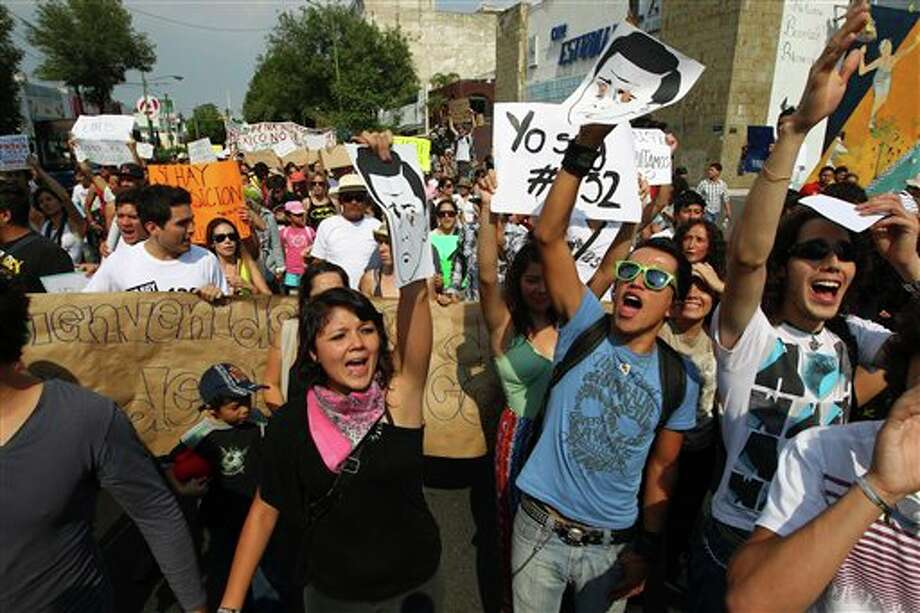 Students belonging to the 132 movement march towards the second presidential debate site in Guadalajara, Mexico, Sunday June 10, 2012. Tens of thousands young demonstrators clogged Mexico City streets Sunday to protest the likely return to power of the country's long-ruling party. (AP Photo/Bruno Gonzalez) Photo: Bruno Gonzalez, Associated Press / AP