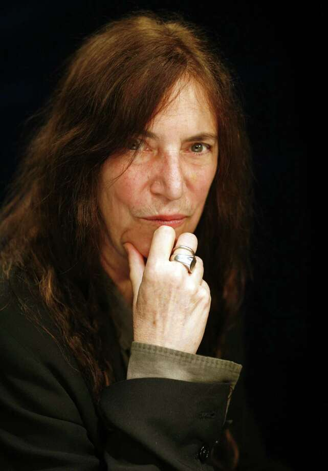 """This May 29, 2012 photo shows musician Patti Smith in New York.  Best remembered for the 1978 hit """"Because the Night,"""" Smith's latest, """"Banga,"""" is her first album of original music in eight years. (AP Photo/John Carucci) Photo: John Carucci"""