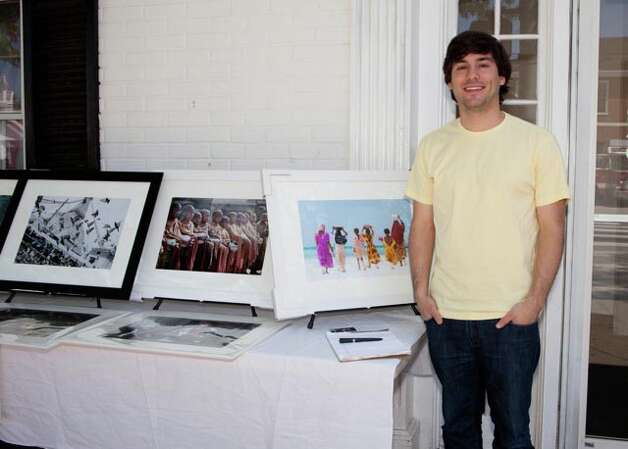 Old Greenwich photographer Darren Ornitz stands by some of his work at an event presented in May by the Old Greenwich Merchants Association and the Art Society of Greenwich (Conn.). From May through July, 2012, area artists will have a chance to display and sell their work at outdoor art fairs held along Sound Beach Avenue and Arcadia Road. For more information, call 203-344-1707. Contributed photo/Cara Gilbride-www.fairfieldcountylook.com Photo: Contributed Photo