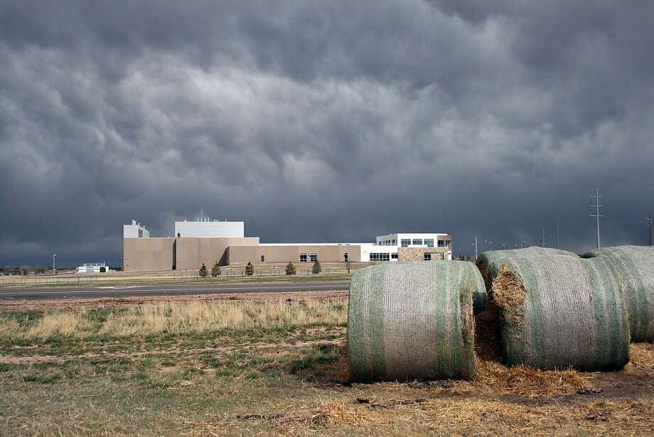 The National Center for Atmospheric Research's Wyoming Supercomputer Center rests on a prairie just west of Cheyenne, beyond these bales of hay.  (Scott Gold/Los Angeles Times/MCT) Photo: Scott Gold, McClatchy-Tribune News Service