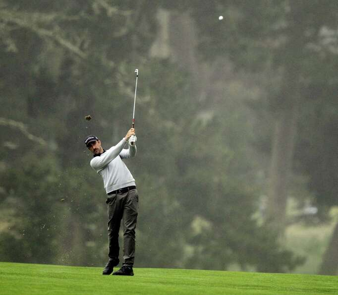Geoff Ogilvy, of Australia, hits a shot on the 14th hole during a practice round for the U.S. Open C