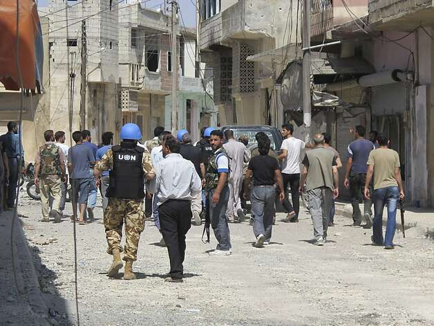 United Nation observers are inspecting a residential area with Free Syrian Army gunmen at the Talbisah area in Homs city Syria Monday June 11, 2012. (AP Photo/David Manyua/United Nations ) Photo: David Manyua, Associated Press