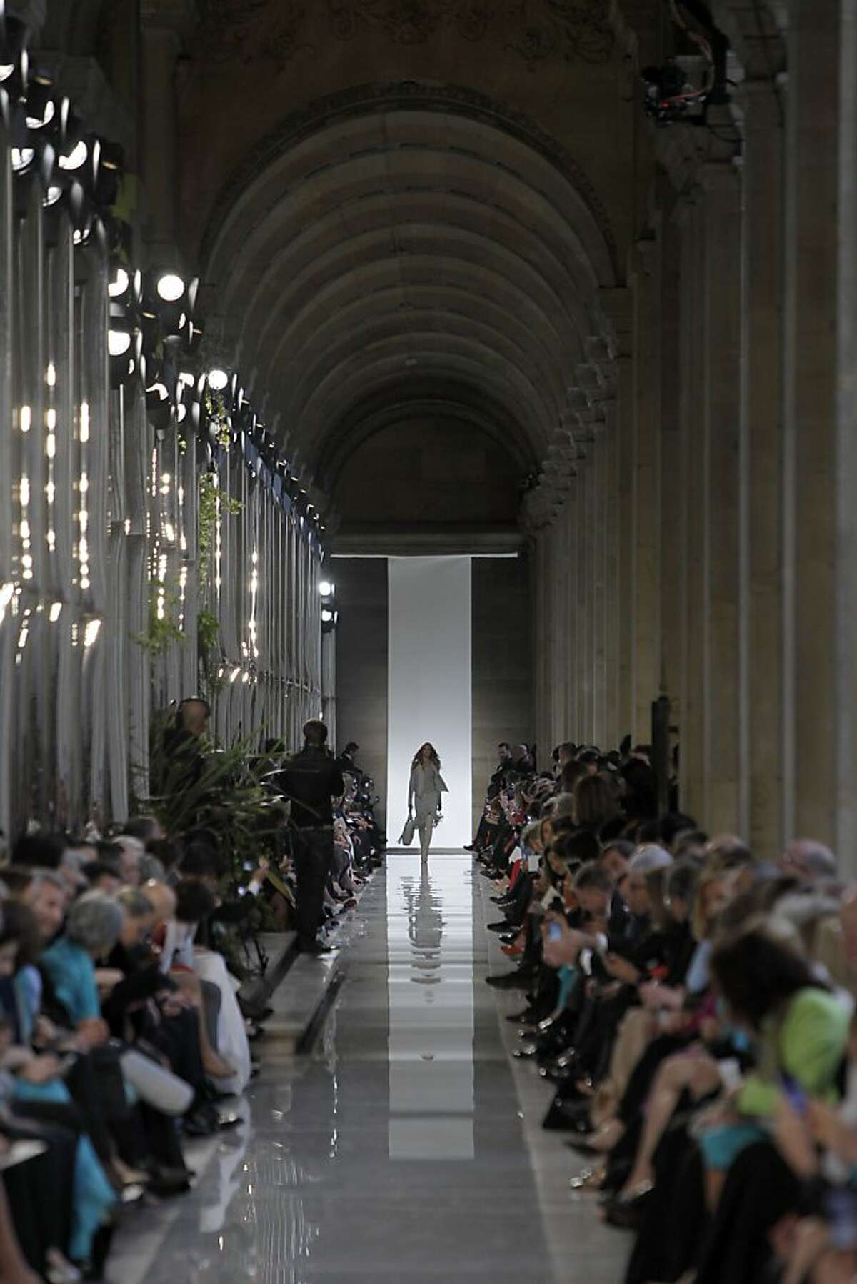 A model displays a creation as part of Salvatore Ferragamo Cruise 2013 fashion show at Louvre Museum in Paris, France, Tuesday, June 12, 2012. (AP Photo/Francois Mori)