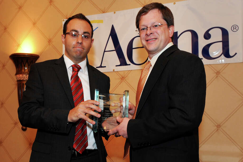 Matthew Pandiscia, left, Agency Benefits Director for Barnum Financial Group, An Office of of MetLife, presents Tom Dillon, Chief Technology Officer for Flagship Networks with the 2012 Barnum Financial Group, An Office of MetLife Volunteer of the Year Award during the Bridgeport Regional Business Council's 138th Annnual Meeting and Luncheon at the Trumbull Marriot, in Trumbull, Conn. June 13th, 2012. Photo: Ned Gerard / Connecticut Post