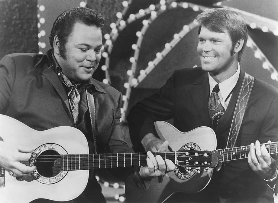 Roy Clark, left, performs with Glen Campbell, who died last year. Clark died Thursday at age 85. >>Here are more notable deaths from 2018...