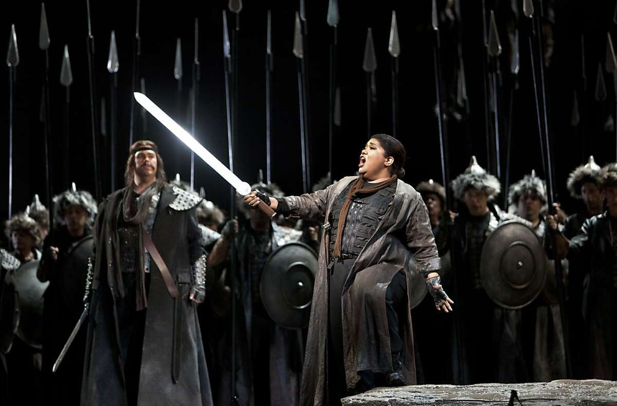 Odabella, daughter of the Lord of Aquileia, played by Lucrecia Garcia, brandishes a sword and props herself on a boulder prop as she lets out a note during the production of Attila. San Francisco's Opera season continues with