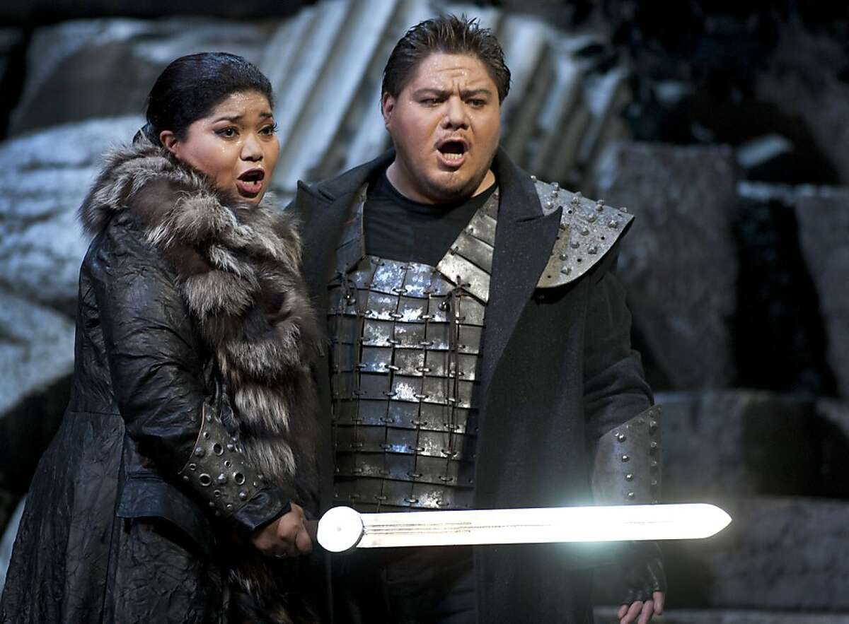 Odabella, daughter of the Lord of Aquileia, played by Lucrecia Garcia (L) and Foresto, a knight of Aquileia, played by Diego Torre (R), sing together onstage during the Attila production at the War Memorial Opera House. San Francisco's Opera season continues with
