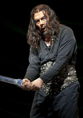 "Attila, King of the Huns, played by Ferruccio Furlanetto holds up a sword as he sings at the front of the stage during the production of Attila. San Francisco's Opera season continues with ""Atilla,"" an opera based on the play Attila, Koing der Hunnen by Zarcharias Werner. Atilla plays at the War Memorial Opera House and is directed by Gabriele Lavia and conducted by Nicola Luisotti. Photo: Kevin Johnson, The Chronicle"