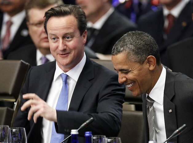 President Barack Obama and British Prime Minister David Cameron laugh together before the meeting on Afghanistan during the NATO Summit, Monday, May 21, 2012, in Chicago. (AP Photo/Carolyn Kaster) Photo: Carolyn Kaster, Associated Press
