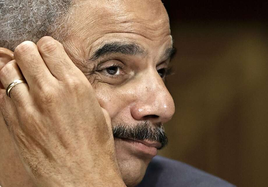 Attorney General Eric Holder testifies on Capitol Hill in Washington, Tuesday, June 12, 2012, before the Senate Judiciary Committee hearing looking into national security leaks. (AP Photo/J. Scott Applewhite) Photo: J. Scott Applewhite, Associated Press