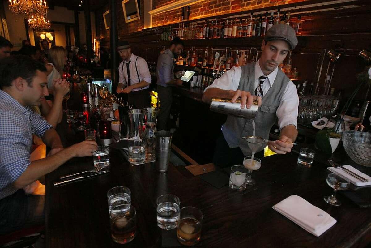 Josh Trabulsi, bartender, makes Blue Skies and Poquito Picante at the bar of Burritt Room+Tavern. Burritt Room+Tavern is a new restaurant/bar across from the Stockton garage in San Francisco, Calif.