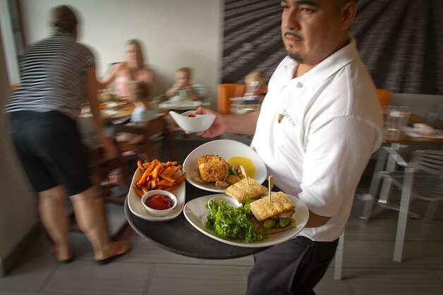 A server brings out food during dinner swerve at Lyfe restaurant in Palo Alto, Calif., on Saturday, June 9th, 2012. Photo: John Storey, Special To The Chronicle