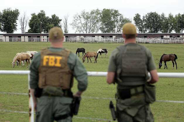 FBI agents overlook a horse ranch under investigation Tuesday, June 12, 2012 in Lexington, Okla. Federal agents raided the Oklahoma ranch and a prominent quarter horse track in New Mexico on Tuesday, alleging the brother of a high-ranking official in a Mexican drug cartel used a horse-breeding operation to launder money. (AP Photo/Brett Deering) Photo: Brett Deering, Associated Press