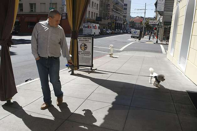 Matt Traywick walking his dog Charlie near his Tenderloin apartment in San Francisco, California, on Tuesday, June 12, 2012. Photo: Liz Hafalia, The Chronicle
